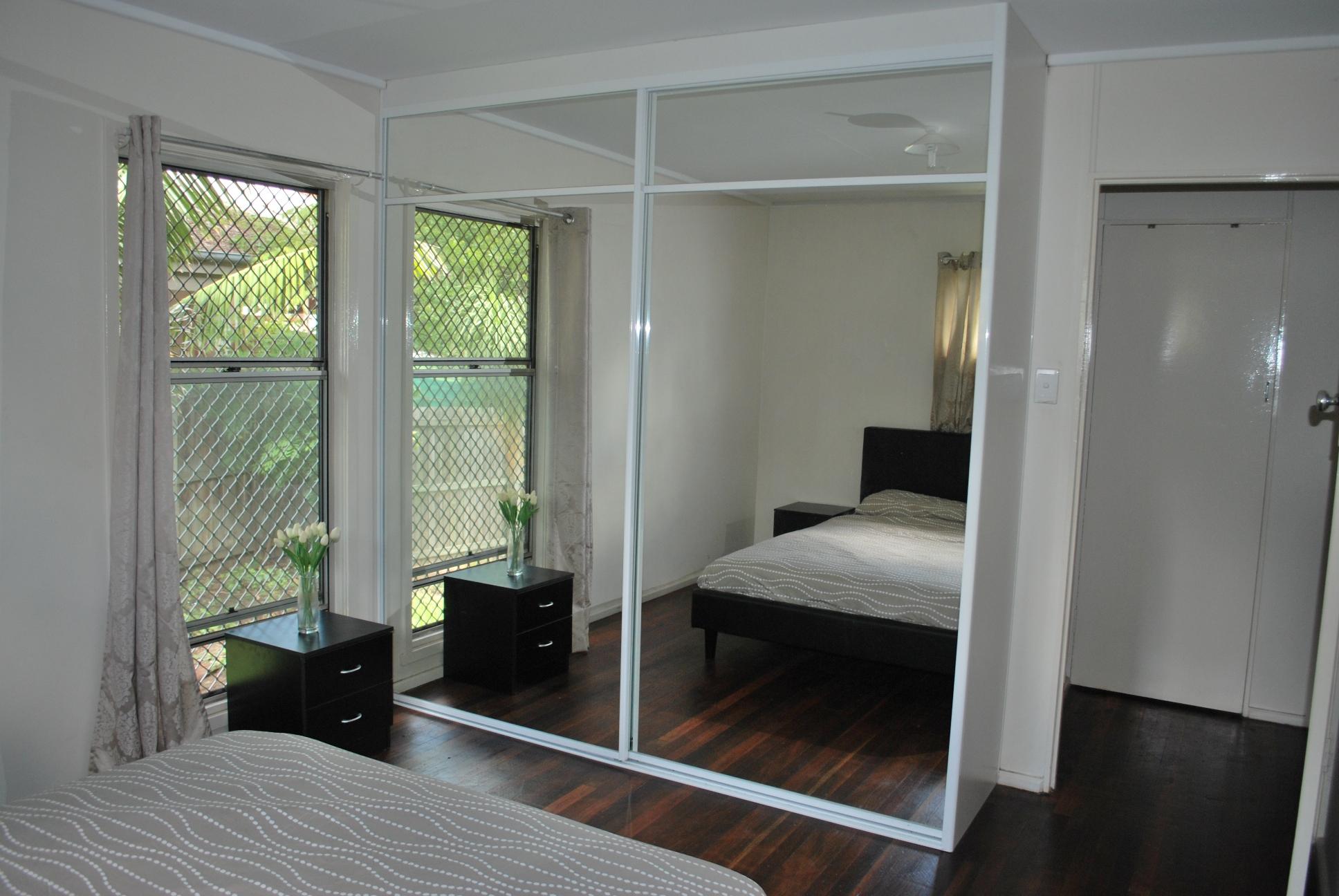 Mirror doors on built in - OZ Wardrobes